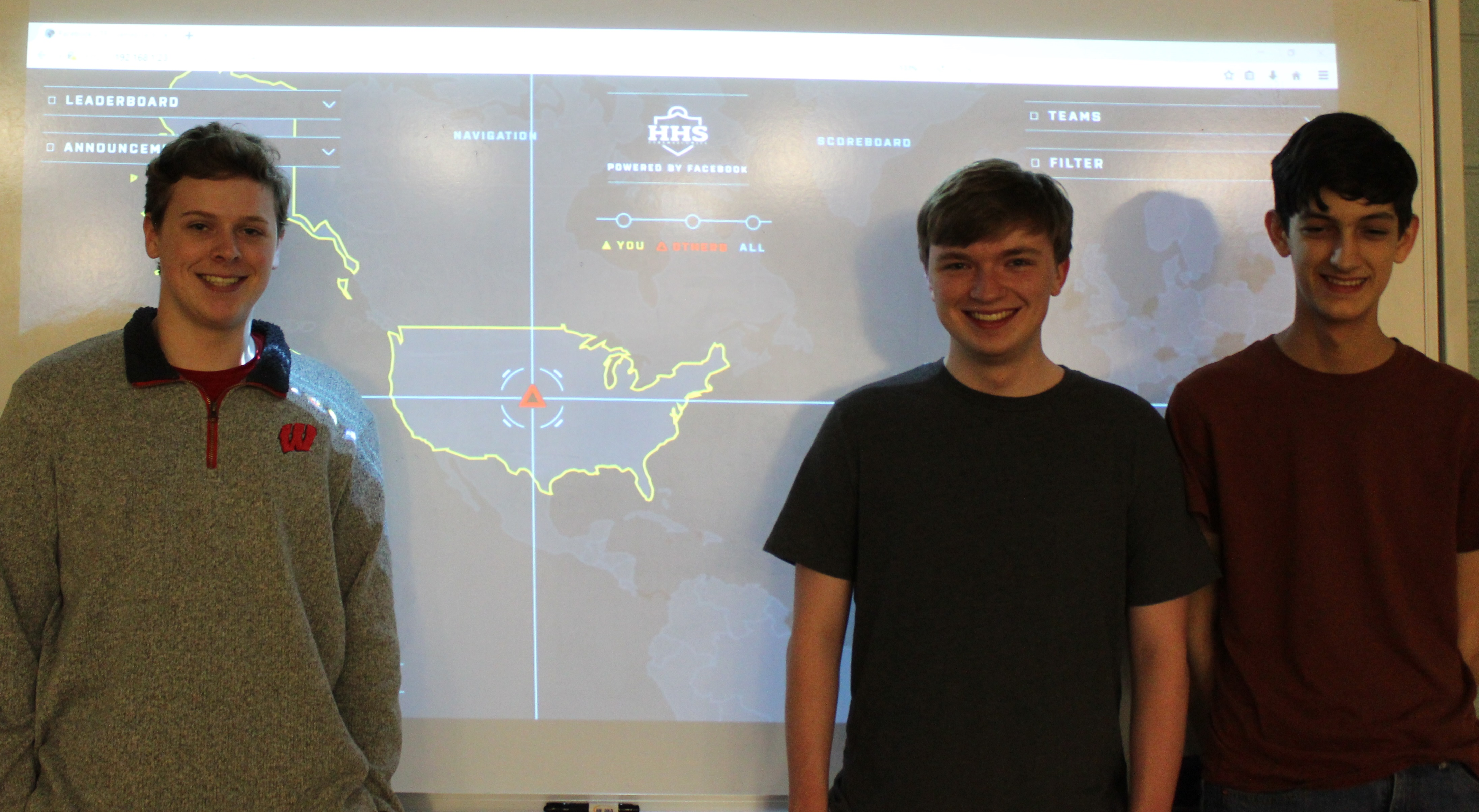 2019 CTF Top Performers Sean Szymanski, Josh Cantrell and Zack Barbre standing infront of the CTF Gameboard.