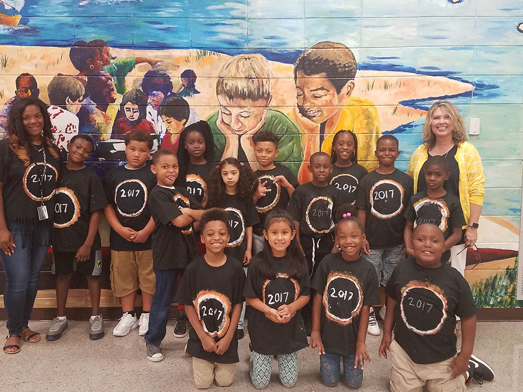 A group of students wearing their eclipse 2017 shirts