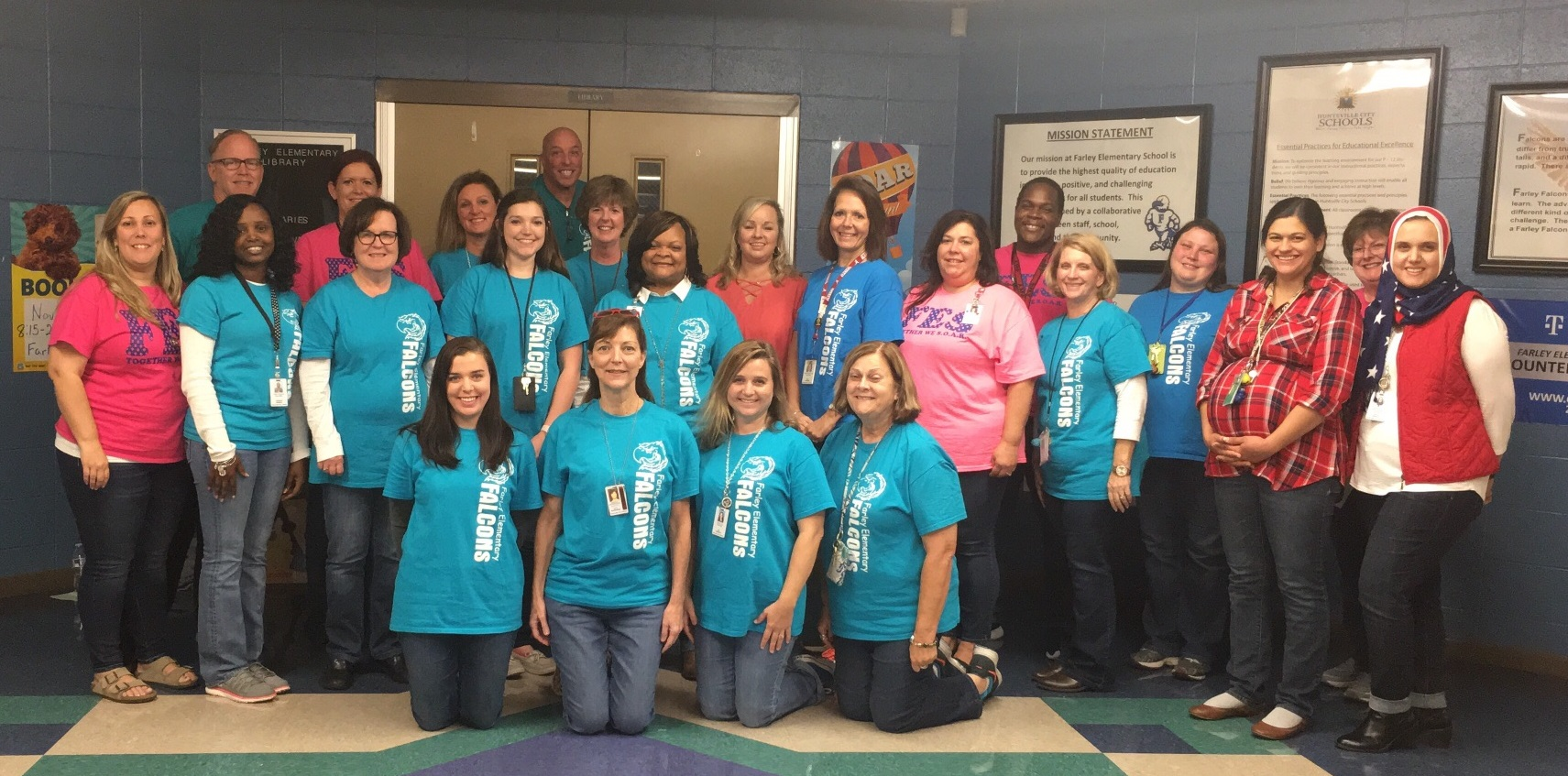 Farley Elementary staff and teachers pose with jeans to show support for Troops for Jeans