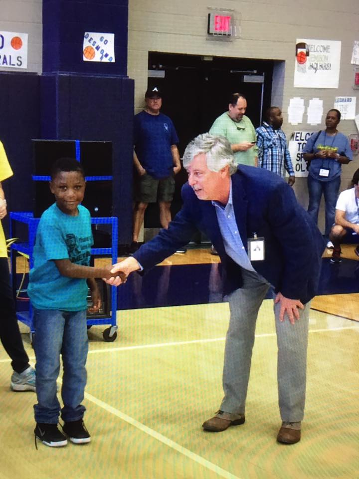 K'Veon Barnes shaking hands with Dr. Akin while accepting his win at the Math Team Competition.