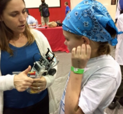 Mrs. DelaMerced talks with a Blossomwood student prior to the state LEGO tournament.