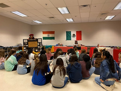 A lady from Peru educating students on her culture