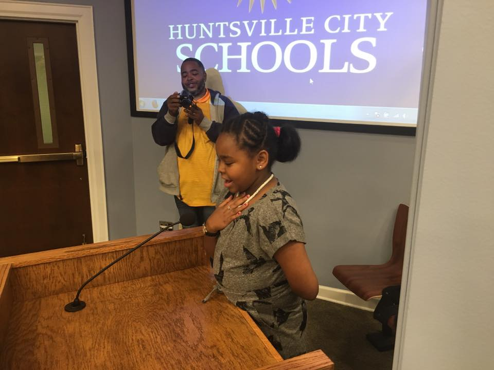 Sannera Heard saying the Pledge of Allegiance at he Board of Education Meeting.