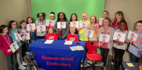 Blossomwood 2019 ACTE participants hold up their certificates while appearing on the morning news show.