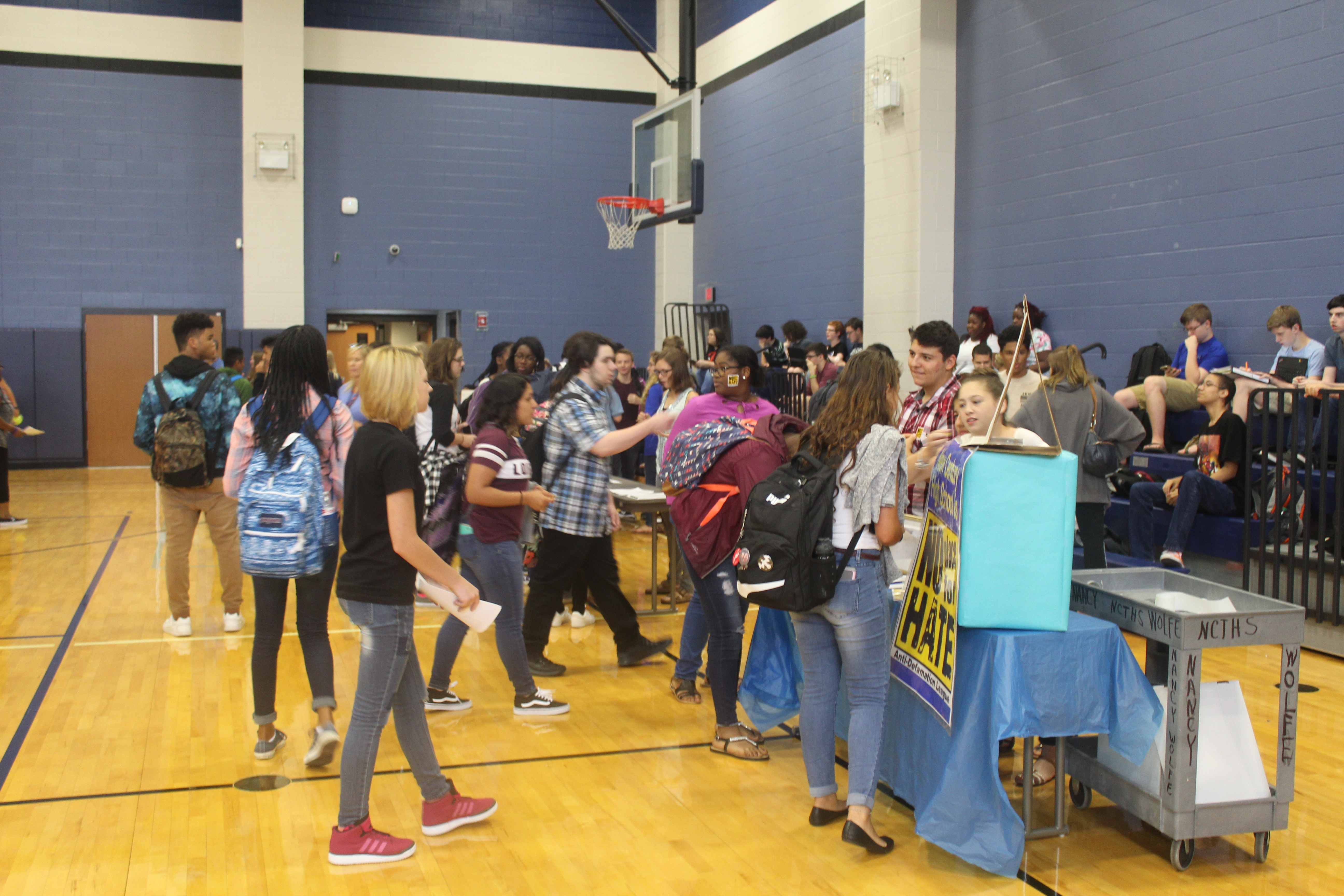 New Century students learning about clubs at the club fair