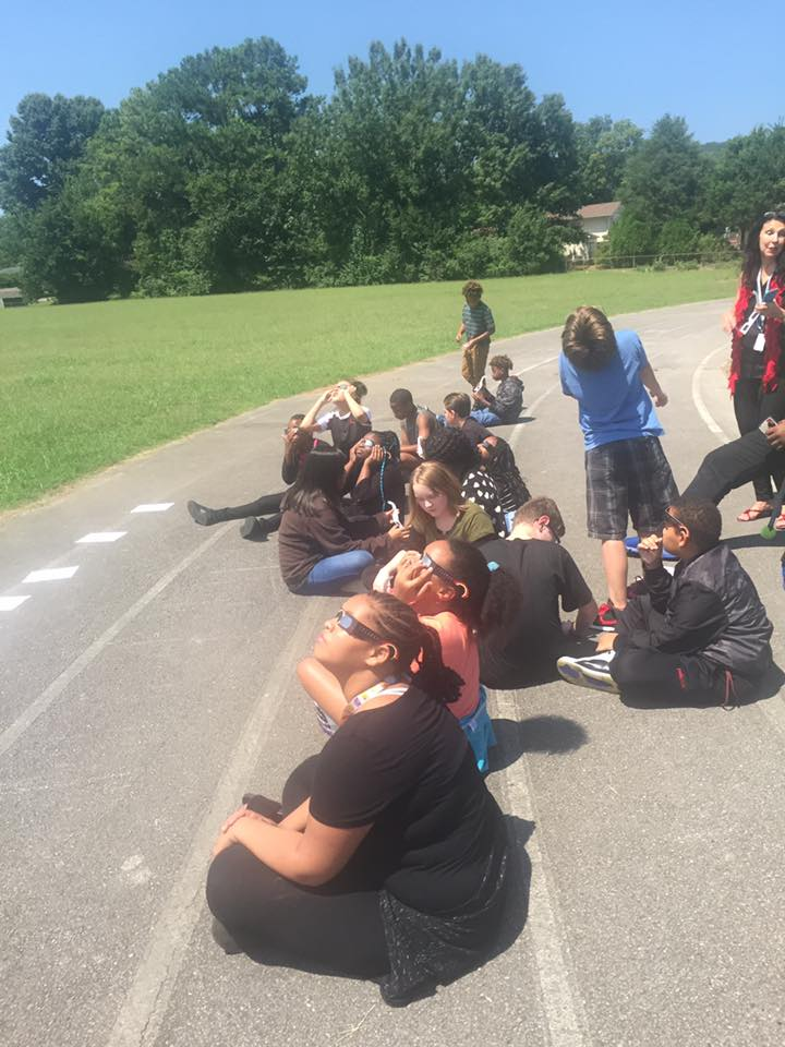 sixth grade watching the eclipse