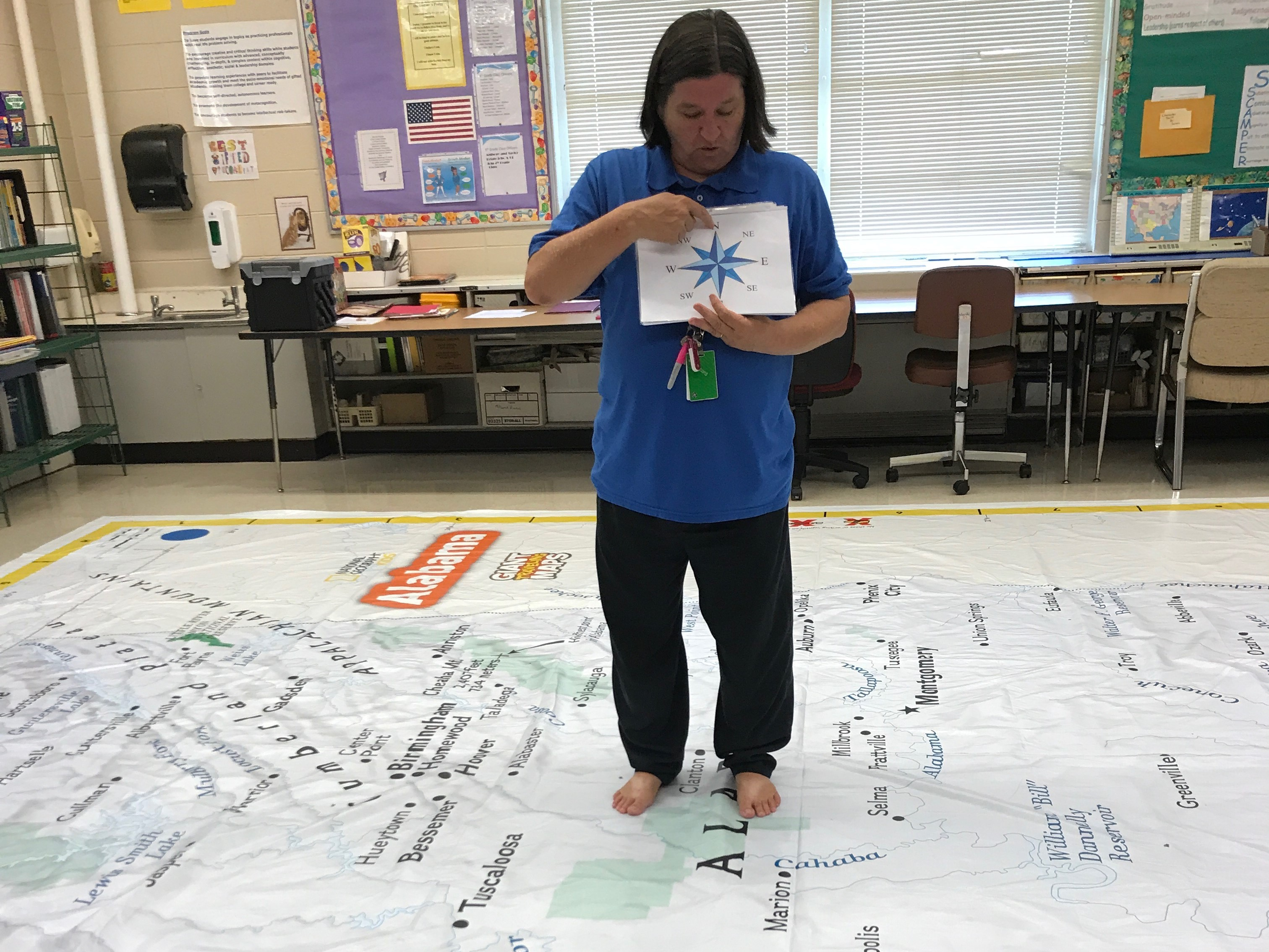 Mrs. Hardee leading a lesson on the giant map of Alabama
