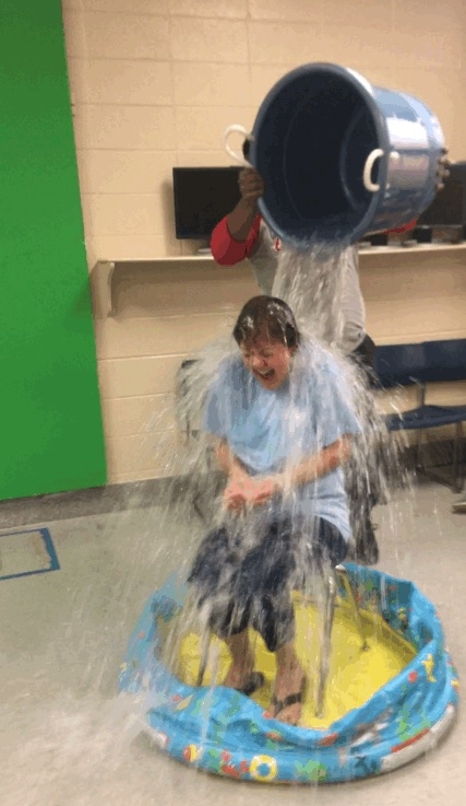 Dr. Wallace being doused with ice water by Mr. Thornton