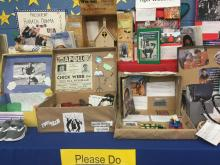 Several Black History time capsules (shoe boxes) filled with memorabilia and artifacts