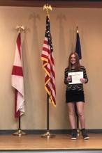Ava accepting her DAR citizenship award