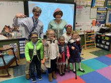 Dr. Scott, Dr. Schliesman, and K students are dressed for the 100th day of shool
