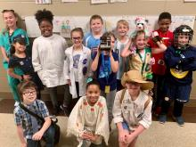 Blossomwood students pose together dressed up for future careers
