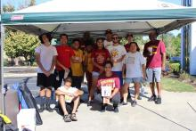 The band members and adult volunteers pose for picture after fundraiser carwash