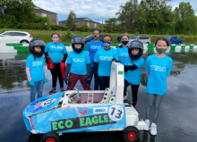 """Challenger Eco Eagles greenpower team with their car, number 13 """"Eco Eagles"""""""