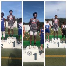 RJ Johnson receiving 1st place for the high jump, triple jump, and long jump.
