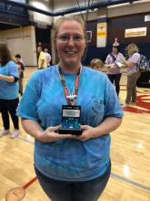 Amy Carter holding the Coach's Award at the First Lego League Competition.