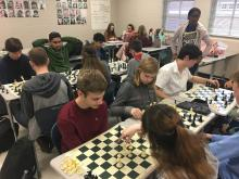 Chess club students participating in games of chess during Power Hour