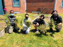 4th and 5th grade students weeding the garden