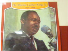Poster Dr. Martin Luther King, Jr. speaking at a microphone with name and 1929-1965 set above him.