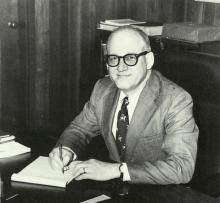 Dr. George Davis Seated at Desk