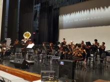The band students playing instruments on the stage in Columbia's auditorium during the Winter concert