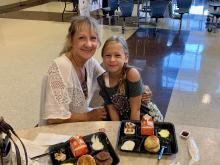 A student poses with her grandmother at the grandparent's breakfast.