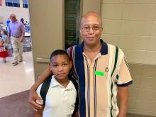 A student poses with his grandfather at the grandparent's breakfast.