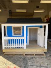 Front of the Blue and White Playhouse for the Habitat for Humanity Project