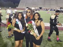 Homecoming Princess, Queen and King pose for picture during half time at Football game at Louis Crews Stadium