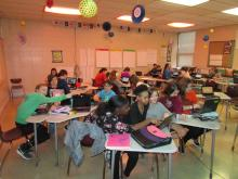 7th Grade Students in Classroom Reviewing Class Schedules