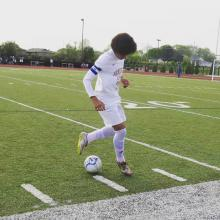 Xavier Ziyenge kicking a ball at a Jemison soccer game.