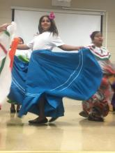 girl dancing in traditiional Mexican costume