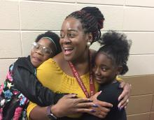 Chandra Branch-Robinson showing surprise as she learns she's been named Montview Elementary School's Teacher of the Year.