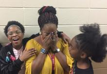 Chandra Branch-Robinson covering her face as she learns she's been named Montview Elementary School's Teacher of the Year.