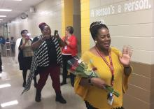 Chandra Branch-Robinson parading down the halls after she's learned  she's been named Montview Elementary School's 2017-18 Teacher of the Year