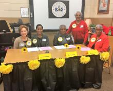 Spelling bee judges at the judges' table