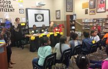 Picture showing judges and students during the spelling bee