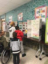 Students learn about hispanic culture through posters created by students