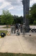 Cadets receiving directions for the rock climbing wall
