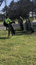 Students from the Eagle Battalion at Columbia High School picking up trash on Jeff Rd  for community service project