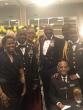 The JROTC Instructors Posing for Picture with 100 Year Old Vet