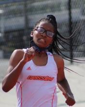 Jerkeisha Lewis running during a track event