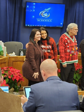 Columbia teacher Kellye Ingraham pictured with Huntsville City School's Superintendent after being recognized for receiving National Boards in Mertz Board Room