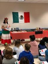 A lady from Mexico educating students about her culture and traditions.