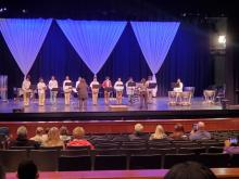 Band members in concert on stage playing musical instruments at Columbia high School