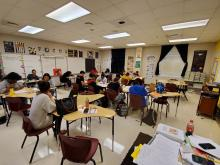 Columbia High School Students in classroom participating in ACT activities and Operation 36 Cap and Gown Project