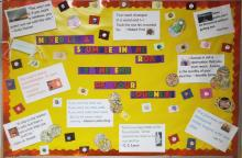 Positive Behavior Bulletin Board with yellow background paper with red border with colored letters and word never let a stumble in the road be the end of your journey