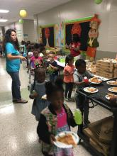 Students receive pizza for PBIS party