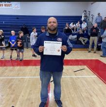 Coach Rhoden holding his Coach of the Year award