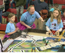 Robotics coach, Amy Carter, assists students during the state competition.